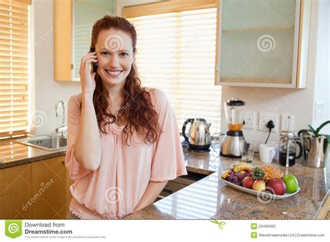 Talking Kitchen by Smiling Talking On The Phone In The Kitchen Stock