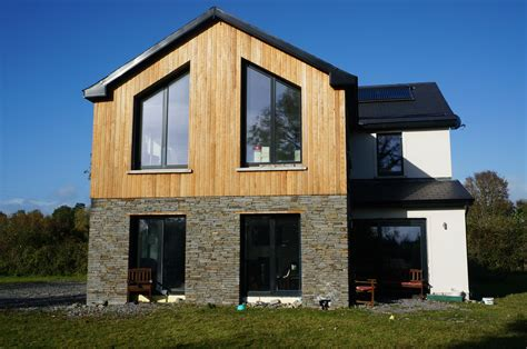 house cladding designs passive house larch cladding dressed stone and white render sustainable design