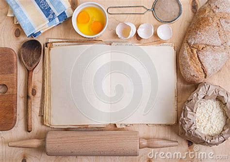 four ingredient cookbook books baking background with blank cook book eggshell flour