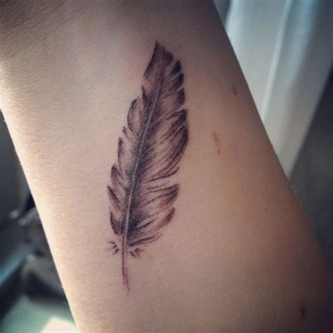 feather tattoo on wrist meaning best 25 feather wrist ideas on feather
