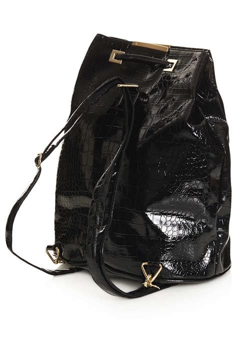 Patent 70s Luggage At Topshop by Lyst Topshop Patent Croc Backpack In Black