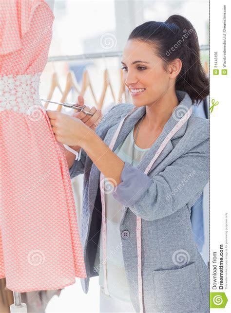 clothes design cutting smilig fashion designer cutting dress royalty free stock
