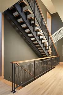 steel banisters these striking steel and wood stairs have water jet cut