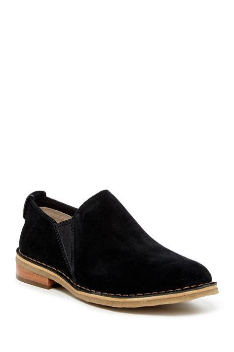 ugg camellia genuine shearling lined slip on shoe in black