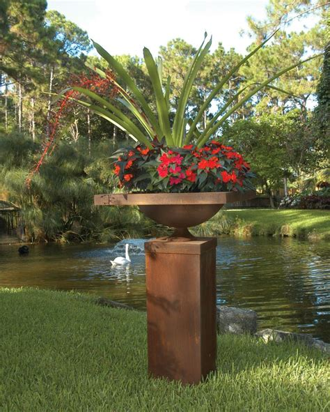 bromeliads form the centerpiece one of my favorite - Container Gardens For Florida