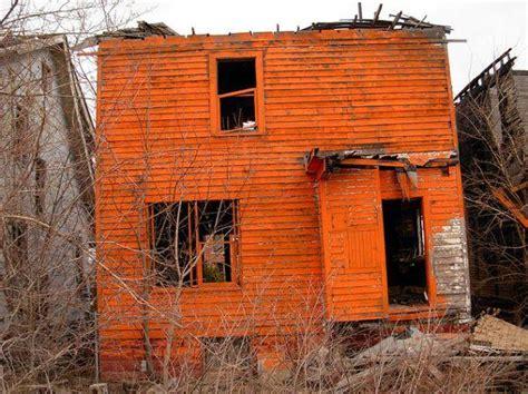 detroit s abandoned houses painted tiggerific orange