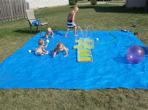 how to make a backyard splash pad cool diy splash pad for your little ones outdoor swim