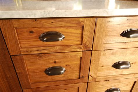rustic walnut cabinets with rubbed bronze cup pulls