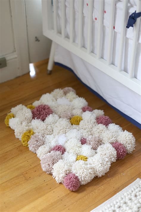 how to make a yarn pom pom rug how to make an awesome diy pom pom rug