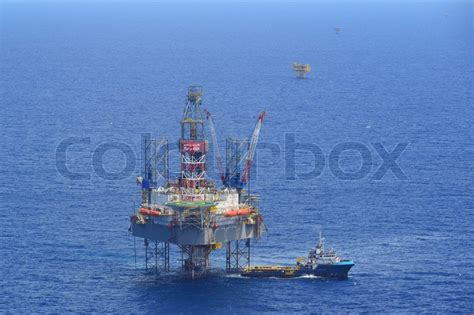 how to get a supply boat job the offshore drilling oil rig and supply boat side view