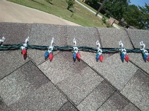 how to put christmas lights on shingle roof hanging lights on your roof or roof line