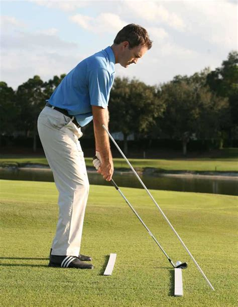 The Golf Swing - the golf swing plane dowel drill