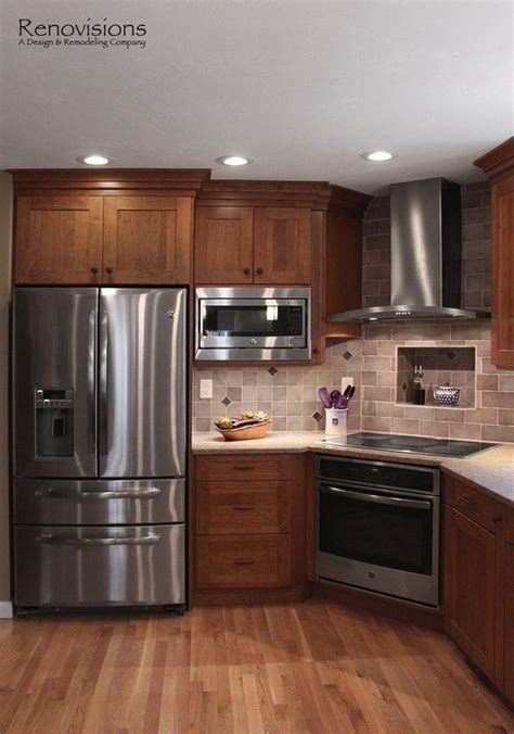black stainless appliances with cherry cabinets kitchen remodel by renovisions induction cooktop