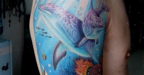 dolphin tattoo on nub arm dolphin the meaning of tattoo full arm saratattooimages