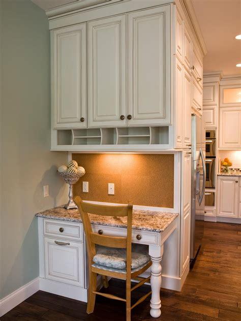 custom designed kitchen desk area features plenty  storage granite countertops   corkboard backsplash home office kitchen desk