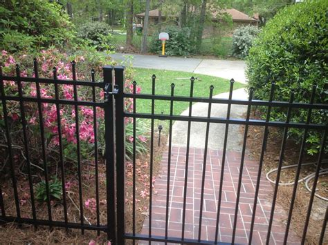 fence gutter cleaning aluminum fences ultimate siding gutters