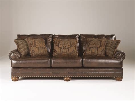 ashley furniture brown leather couch ashley brown leather durablend antique sofa by ashley