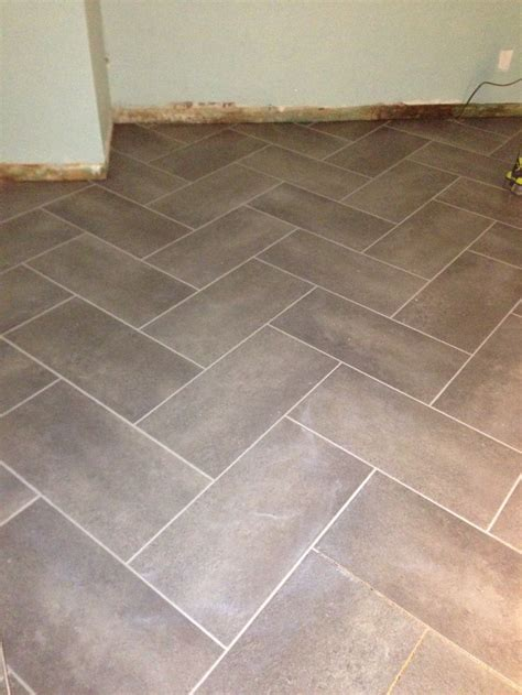 coastal grey resilient vinyl tile flooring  sq ft case herringbone