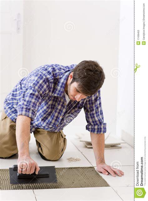 home improvement handyman laying tile stock photos