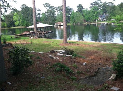 Backyard slope at lake needs budget friendly landscape or