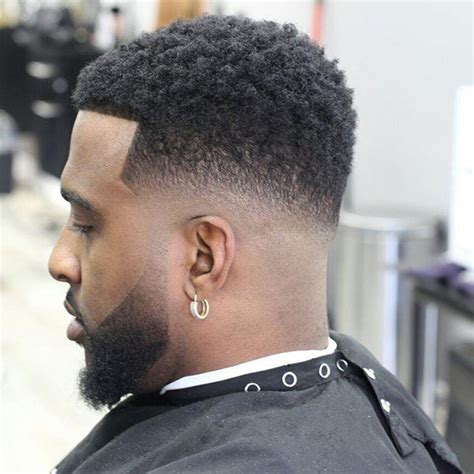 blowout hairstyles for black men a line in the side the trendiest taper haircut black men in 2018