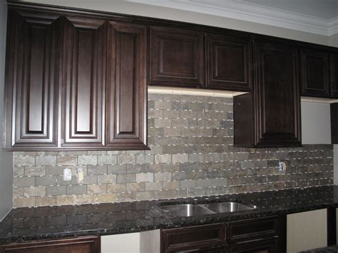 gray countertops with brown cabinets gray tile back splash with dark brown wooden cabinet