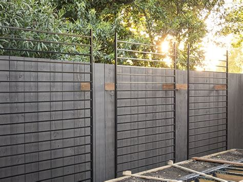 Trellis Home Using Metal Fence Panels As Trellises For The Vertical