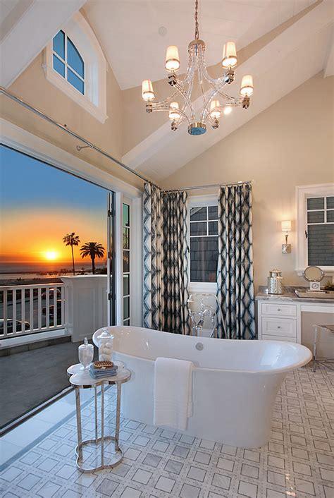 chandelier above bathtub ultimate california beach house with coastal interiors