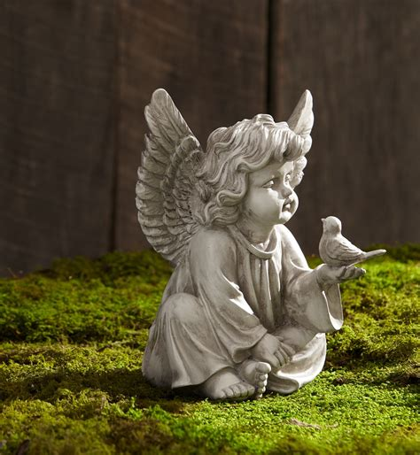 cherub with bird sign statuary garden rock yard ornament