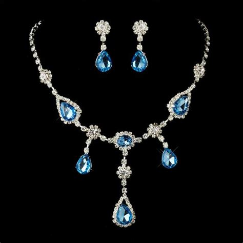 4 sets of silver clear light blue necklace earrings
