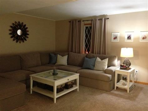 pretty wall color with tan couch f a m i l y r o o m with white walls tan couch and brown carpet blue curtains