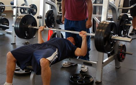 how to bench press how to increase your barbell bench press weight training