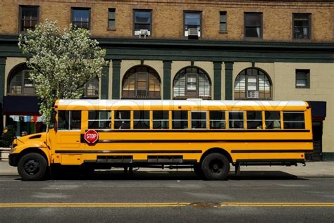 Rude American yellow school bus in new york city stock photo colourbox