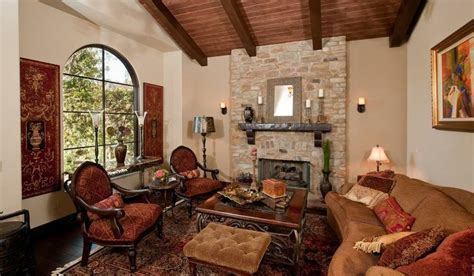 tuscan living room with stone fireplace and note the tuscan living room warm colors wood beam ceiling and
