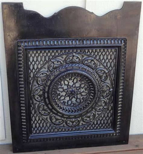 antique black enameled cast iron ornate cut out