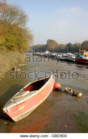 richmond upon thames river cruise a small boat sits in very low tide along the river thames