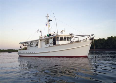 converted tug boats for sale uk australia to southeast asia in a converted fishing boat