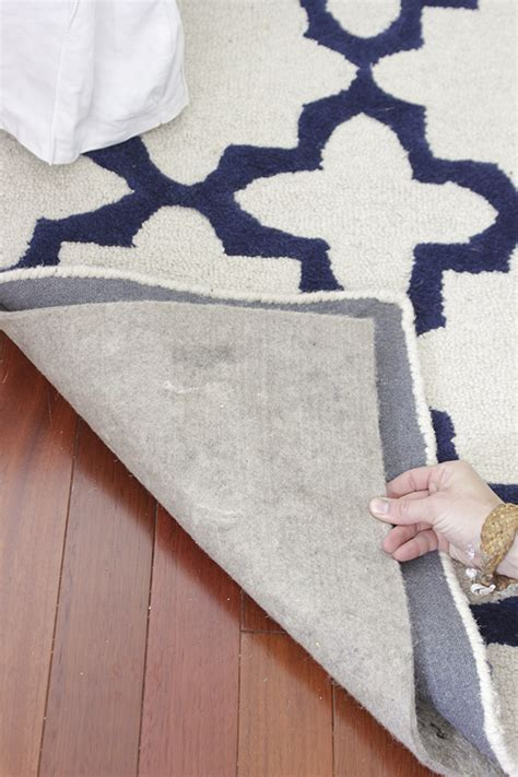 are rug pads necessary blue white in the living room a rug pad giveaway