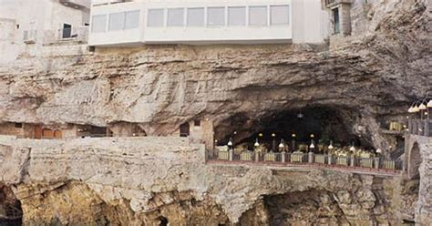 cave restaurant side of a cliff italy puglia s italian restaurant in a cave tucked away into