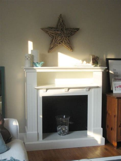 Faux Fireplace Surround by Best 25 Shelf Above Tv Ideas On Laundry Room