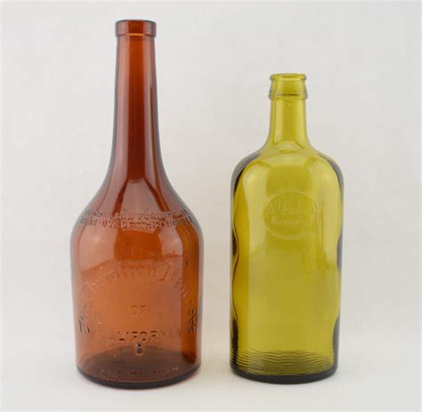 green liquor handling st peters brewery bottle and christian brothers liquor bottle green brown whiskeys