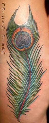 peacock feather tattoo hip marcy nielsen edmonton tattoo artist peacock feather