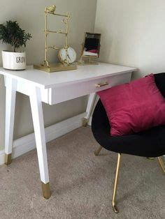 white desk with gold legs gilded gold painted navy blue chair a little bit gold