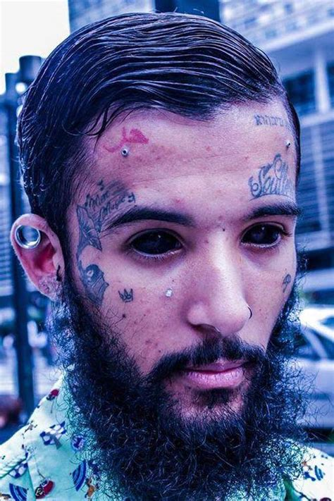 eyeball tattoo photos hot these 18 people have their eyeballs tattooed and it s the
