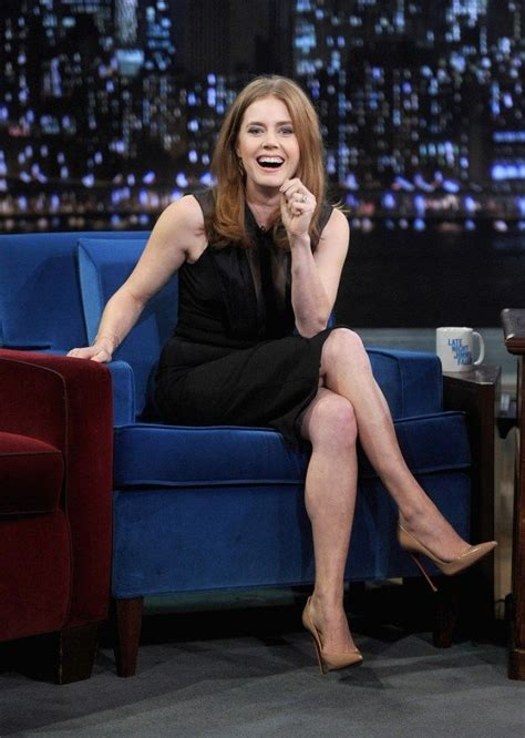 Talk About High Heel by Crossed Legs In A Black Dress And High
