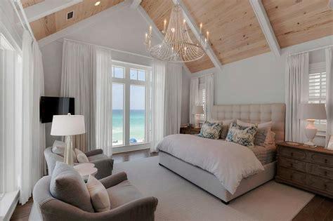 beach style bedroom with reading corner cottage bedroom cream art deco headboard with brass nailhead trim