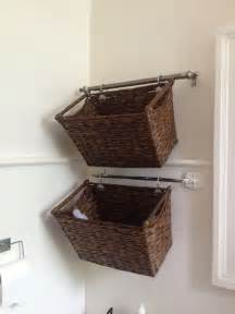 Bathroom Storage Basket Cut A Curtain Rod And Hang Wicker Baskets For Easy Bathroom Storage Storage