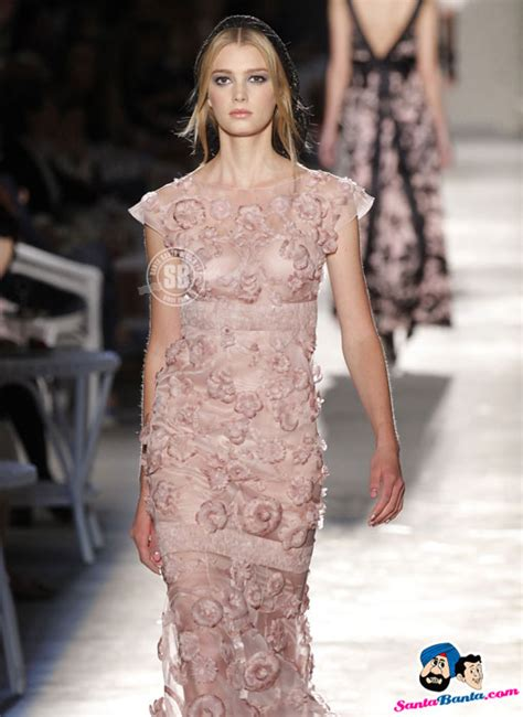 italian house that designs haute couture a model presents a creation by german designer karl lagerfeld for french fashion