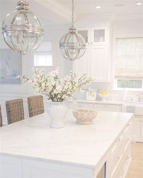 white kitchen carrara marble bamboo roman shades rattan