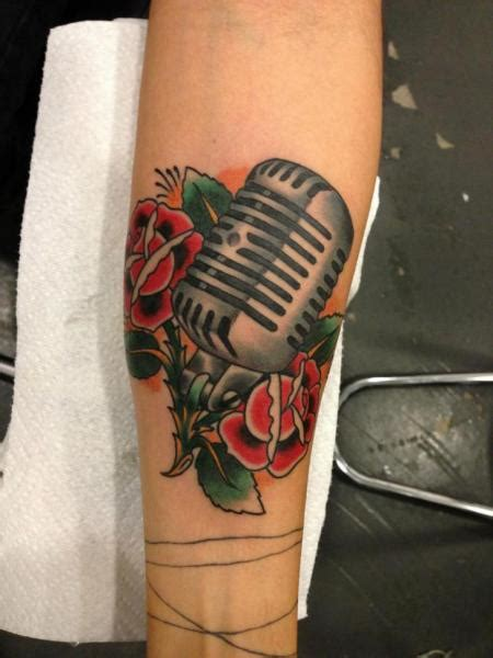 microphone flower tattoo arm new school flower microphone tattoo by power tattoo